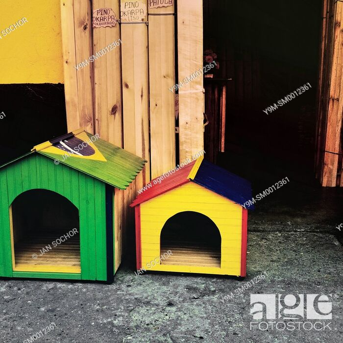 Stock Photo: Dog houses, painted in national flag colors of Brazil and Colombia, are seen for sale on the street in Cali, Colombia, 26 June 2014.