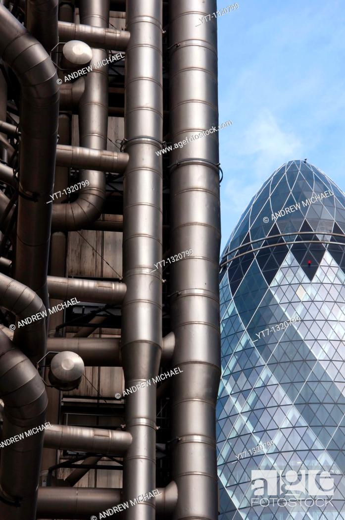 Stock Photo: Lloyds of London and the Gherkin buildings in the Financial district of London, England.