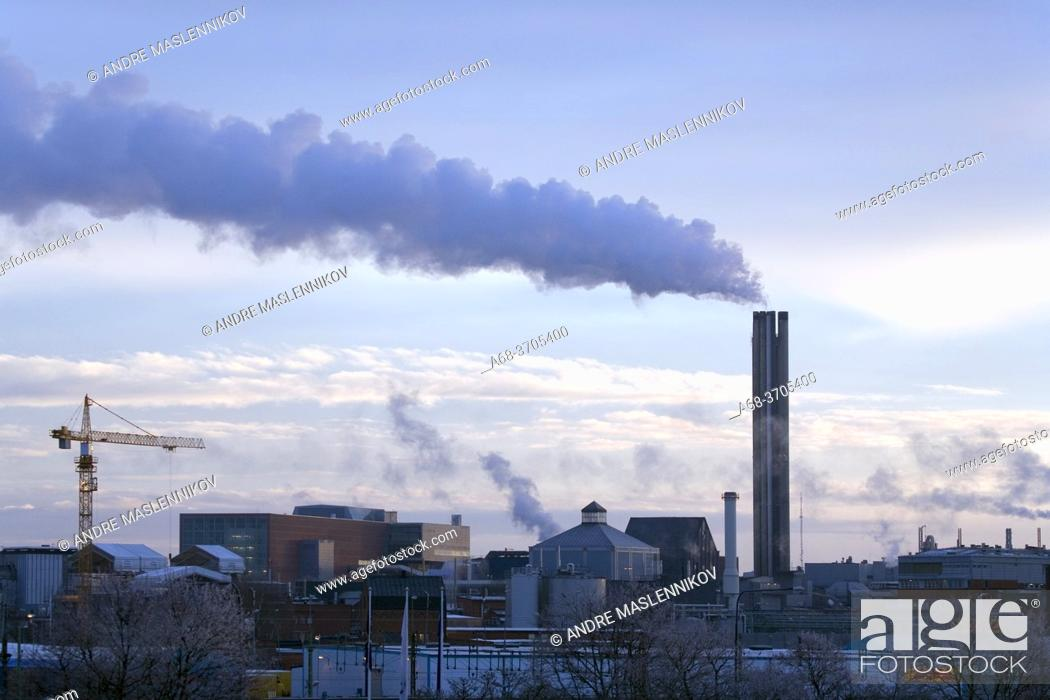 Stock Photo: The chimney with smoke from the district heating plant in Uppsala, Sweden.