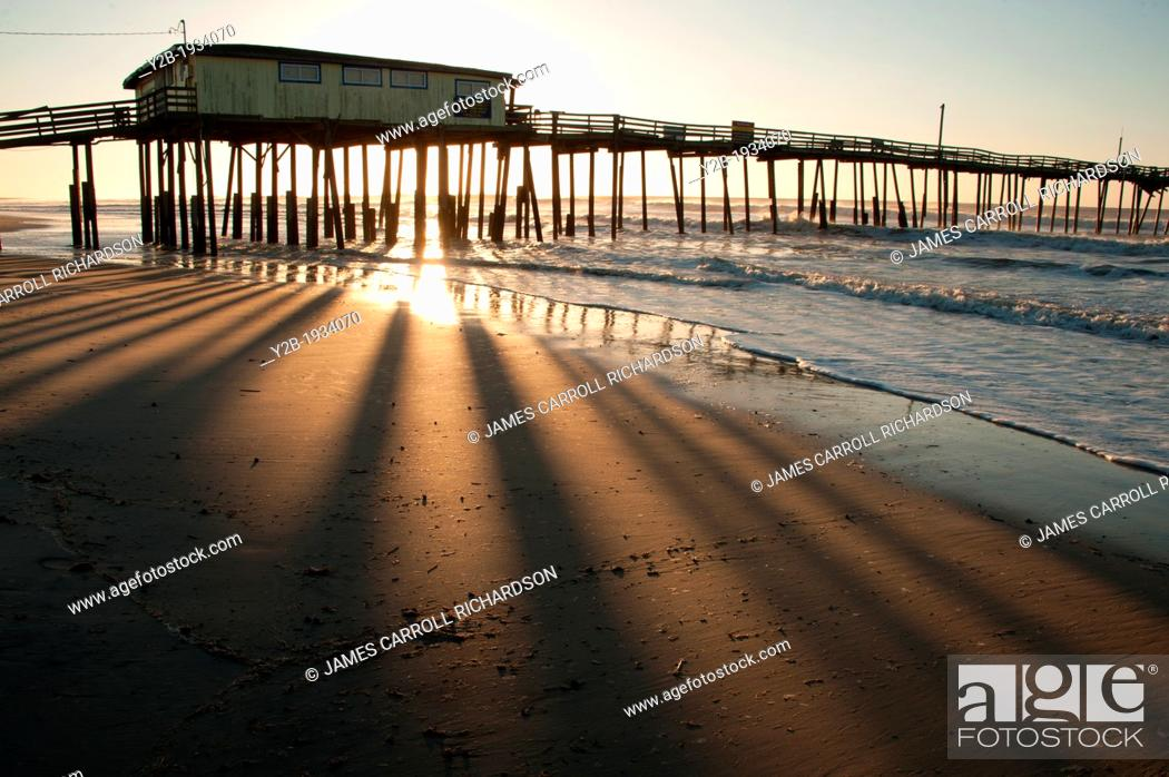 Stock Photo: Sunrise on abandoned pier in North Carolina's Outer Banks USA.