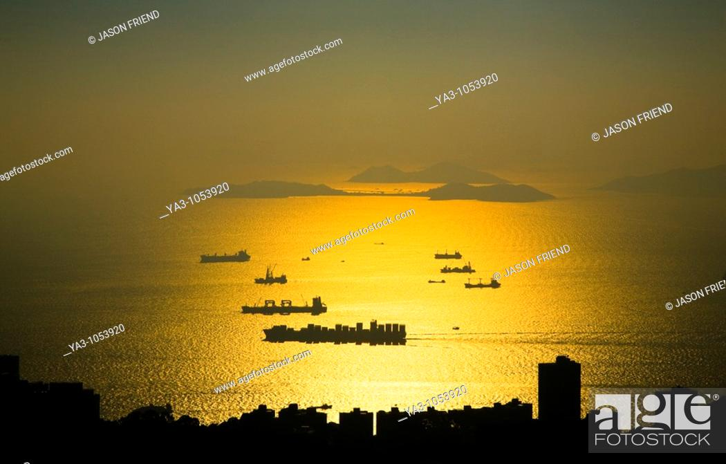 Stock Photo: People's Republic of China, Hong Kong Special Administrative Region, Hong Kong Island  Sunset viewed from near the Peak complex.