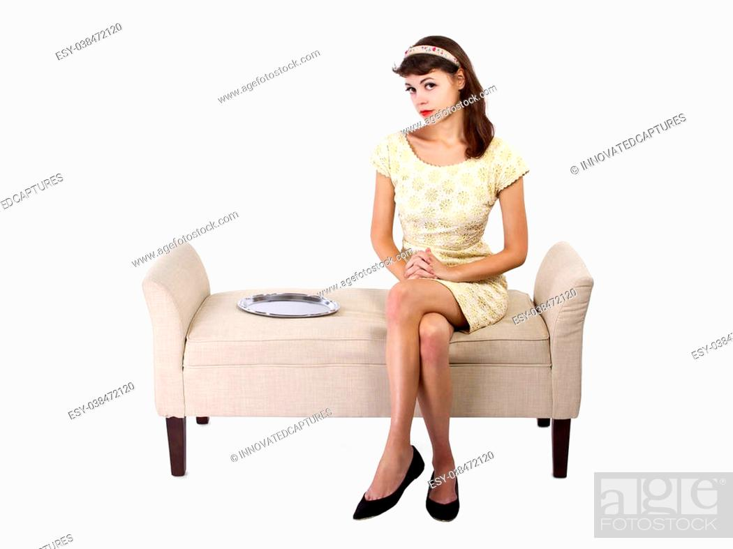 Photo de stock: young female looking unsure sitting next to an empty dessert tray. empty serving tray for composites.