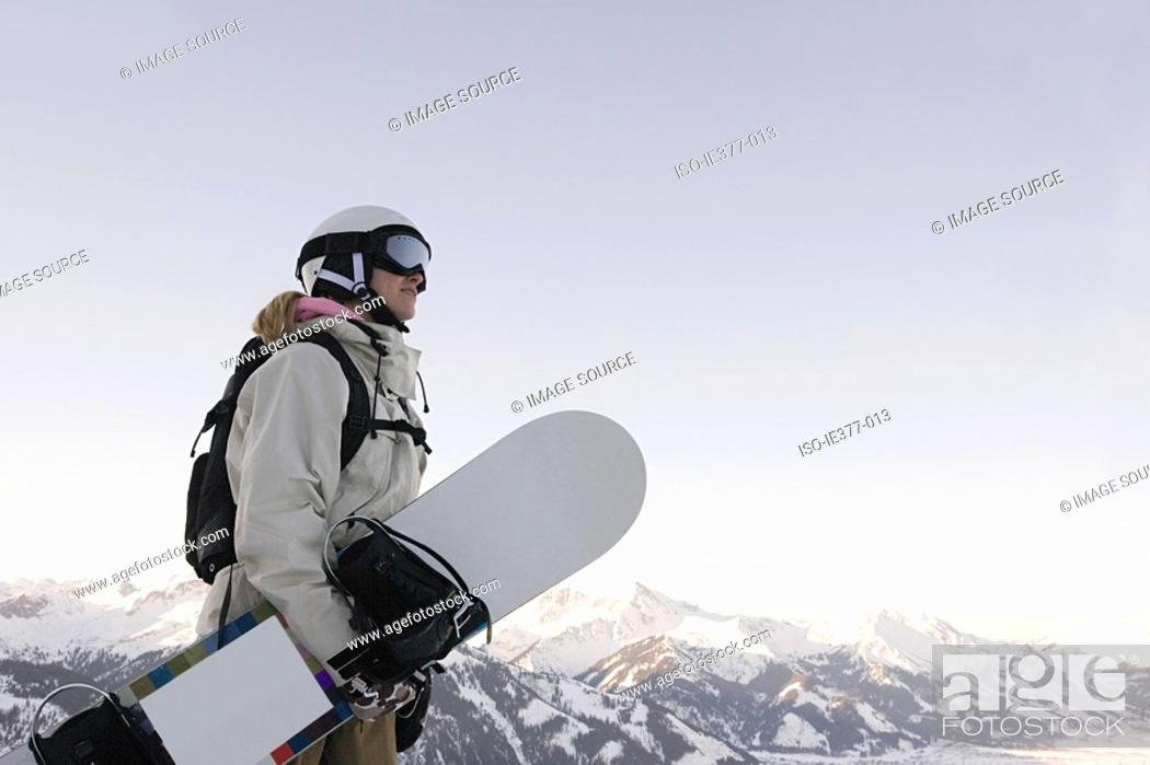 Stock Photo: A woman holding a snowboard.