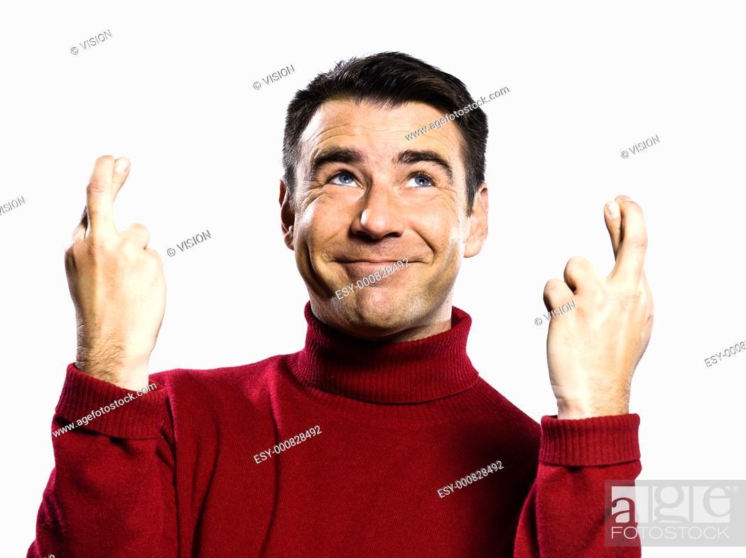 Stock Photo: caucasian man finger crossed gesture studio portrait on isolated white backgound.