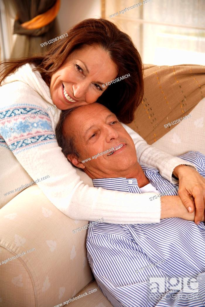 Stock Photo: Mature couple relaxing at home.