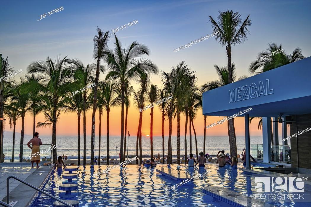 Stock Photo: Sunset at the swimming pool of Riu Resort Hotel, Nuevo Vallarta, Riviera Nayarit, Mexico.