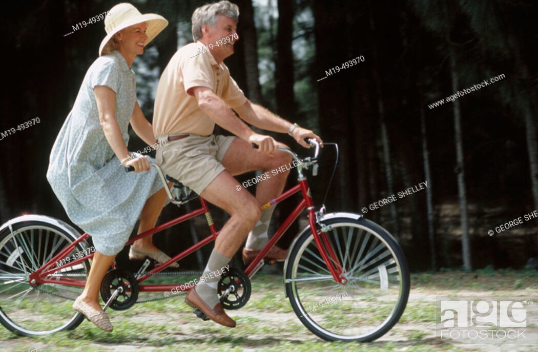 Stock Photo: couple on a tandem bike.