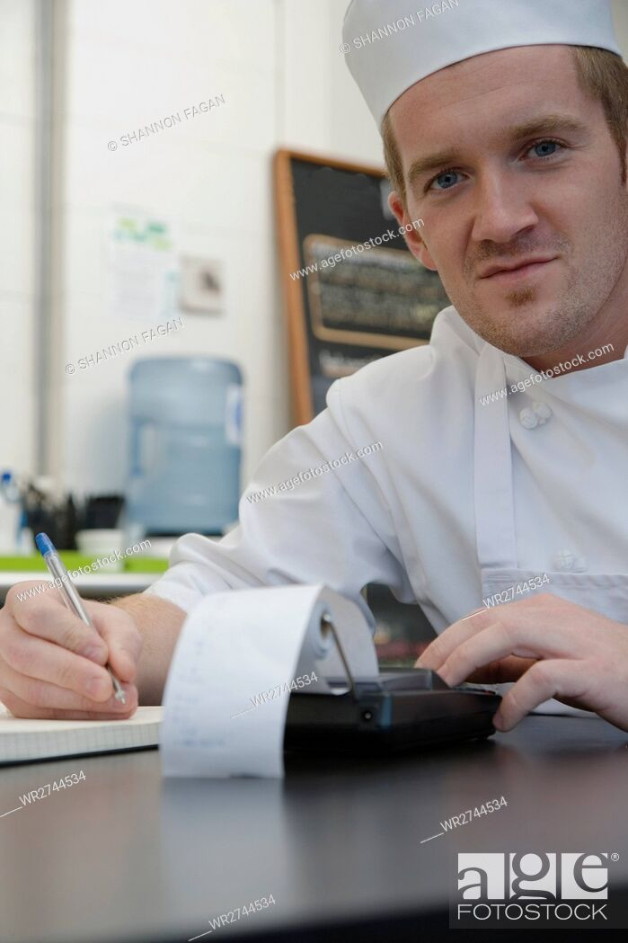 Stock Photo: Chef with calculator.