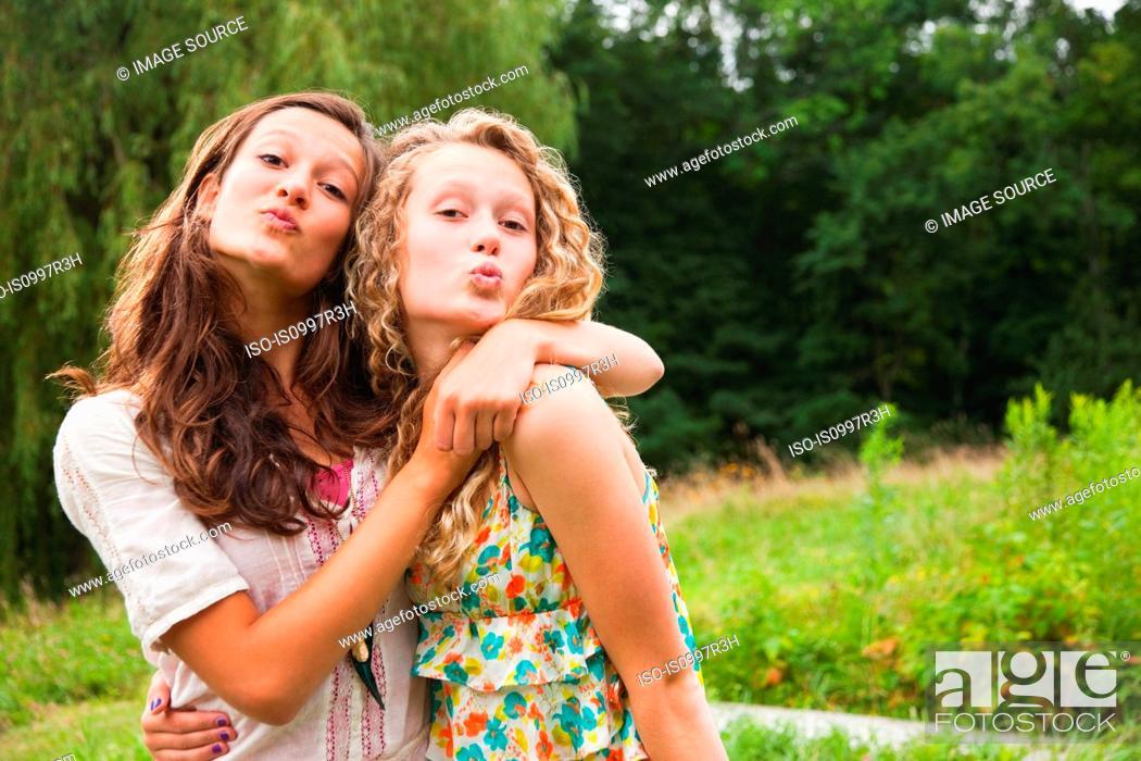 Stock Photo: Teenage girls fooling around and puckering lips.