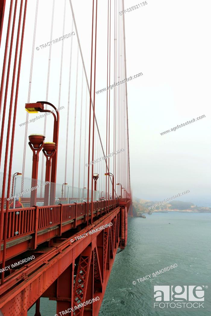 Stock Photo: A view of the side of the Golden Gate Bridge, Marin County and the Pacific Ocean from a viewing area on the Golden Gate Bridge on a foggy, smog filled day.