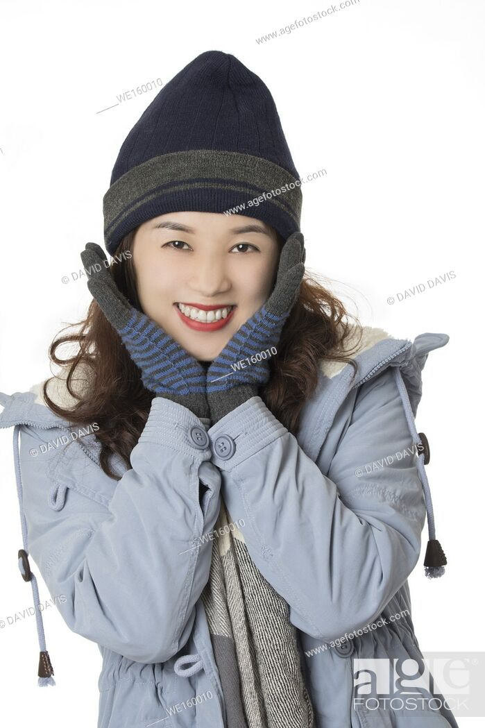 Stock Photo: Beautiful Asian woman wearing winter clothes isolated on a white background.