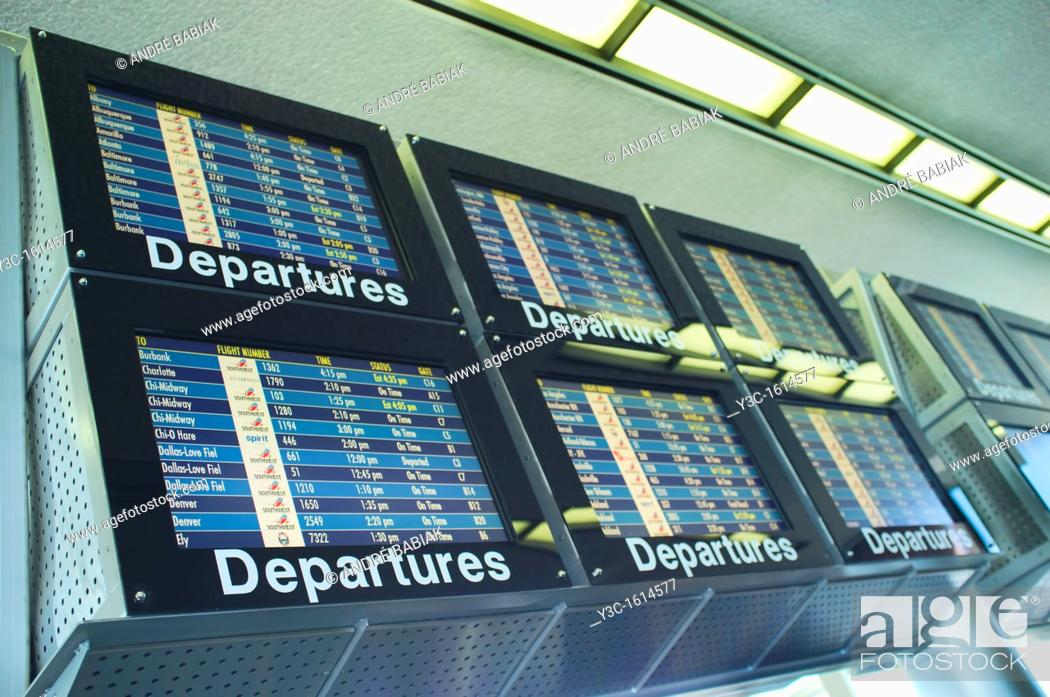 Stock Photo: Airport Departures Timetable.