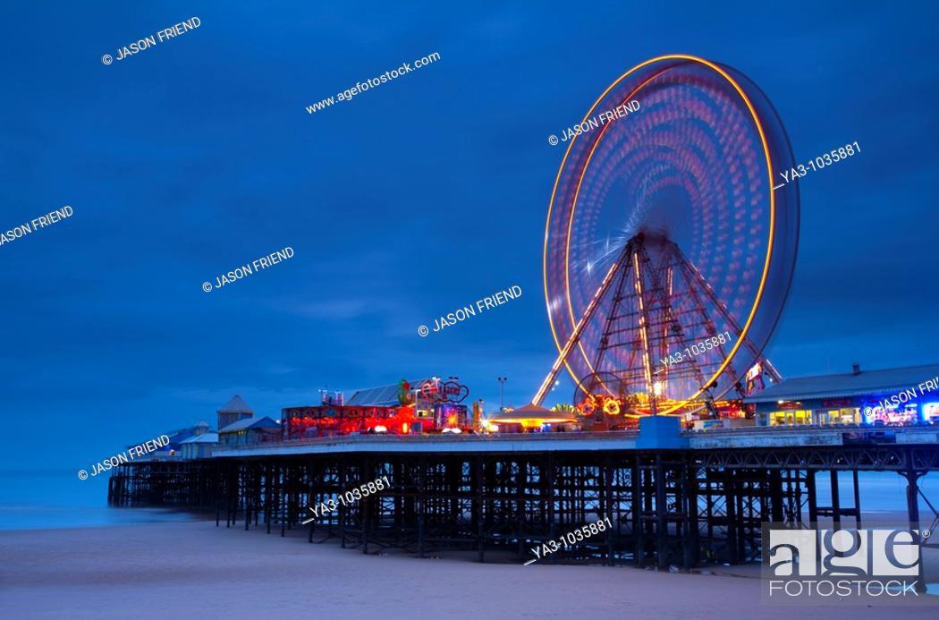 Stock Photo: England, Lancashire, Blackpool  Blackpool Central Pier at dusk.