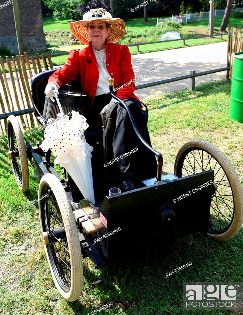 """Stock Photo: A woman sits in a Henry Ford- Quadricycles from 1896 at the vintage car festival """"""""11. Classic Days"""""""", in Juechen, Germany, 06 August 2016."""
