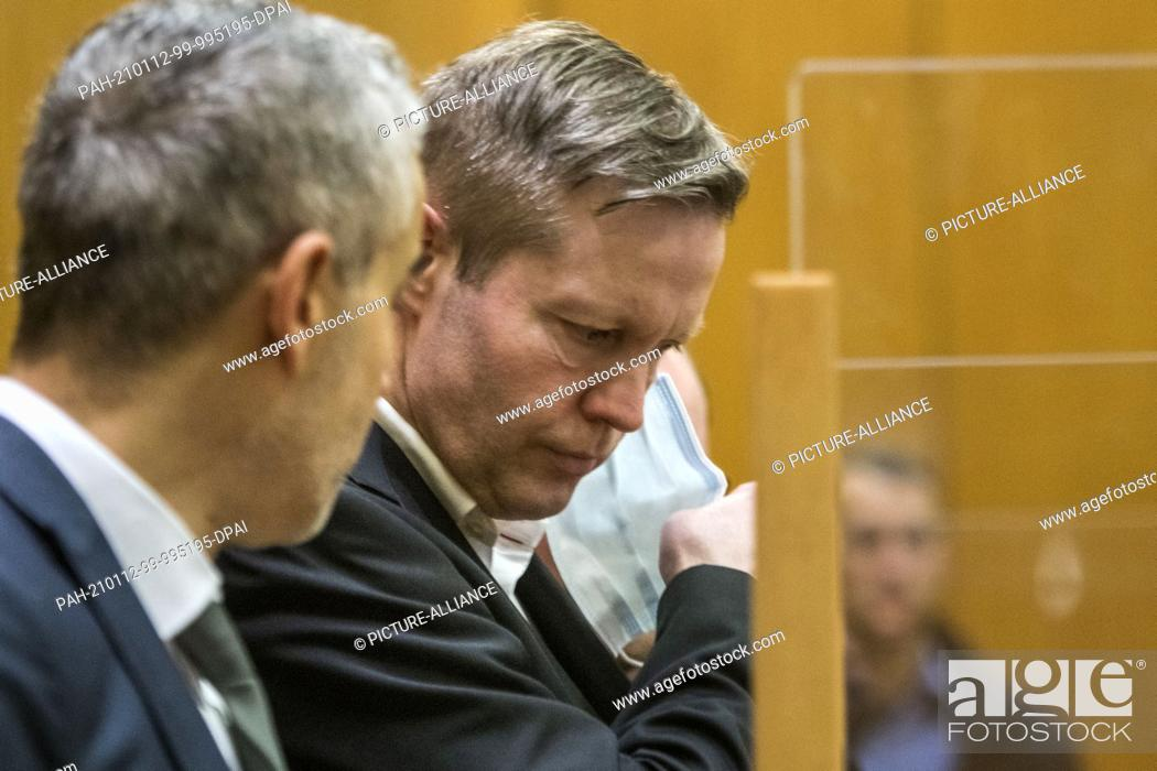 Stock Photo: 12 January 2021, Hessen, Frankfurt/Main: Main defendant Stephan Ernst (2nd from left) stands next to his lawyer Mustafa Kaplan in a courtroom at the Higher.