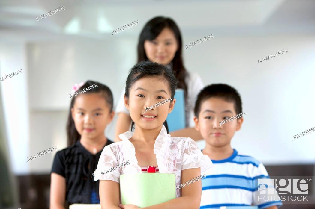 Stock Photo: Child, Three children standing with teacher.