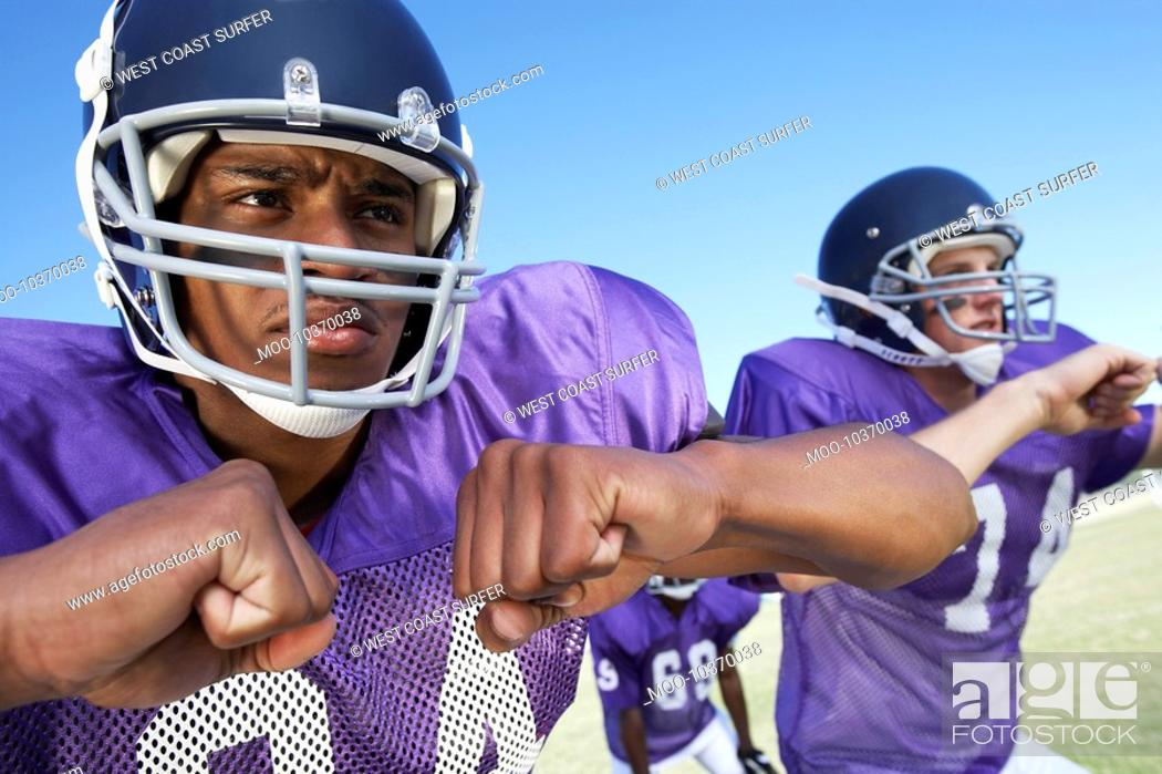 Stock Photo: Two Football Players clenching fists on field close-up close-up.
