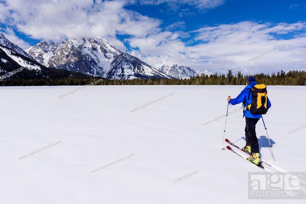 Stock Photo: Backcountry skier under Mount Moran, Grand Teton National Park, Wyoming USA.