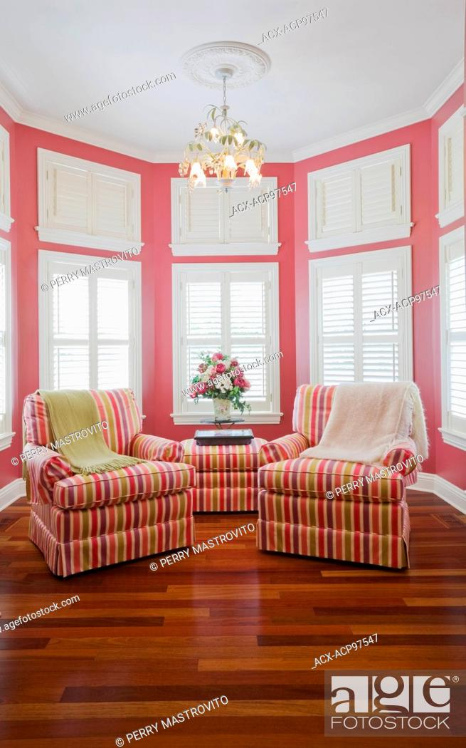 Pink And Green Striped Upholstered Sitting Chairs In Alcove