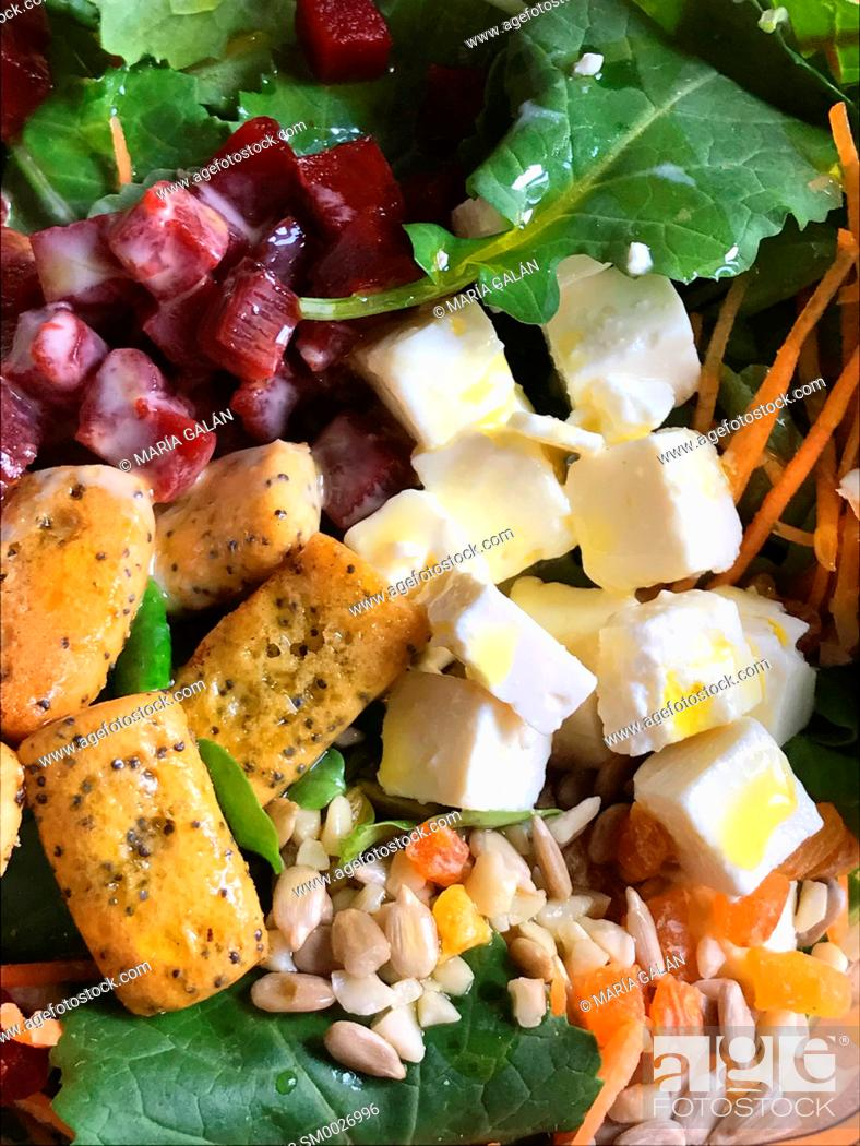 Stock Photo: Salad made of cottage cheese, beetroot, rocket, seeds, toast and olive oil.