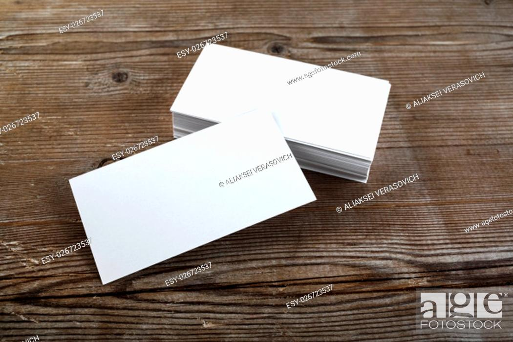 Stock Photo: Photo of blank business cards on a wooden background. Template for ID.