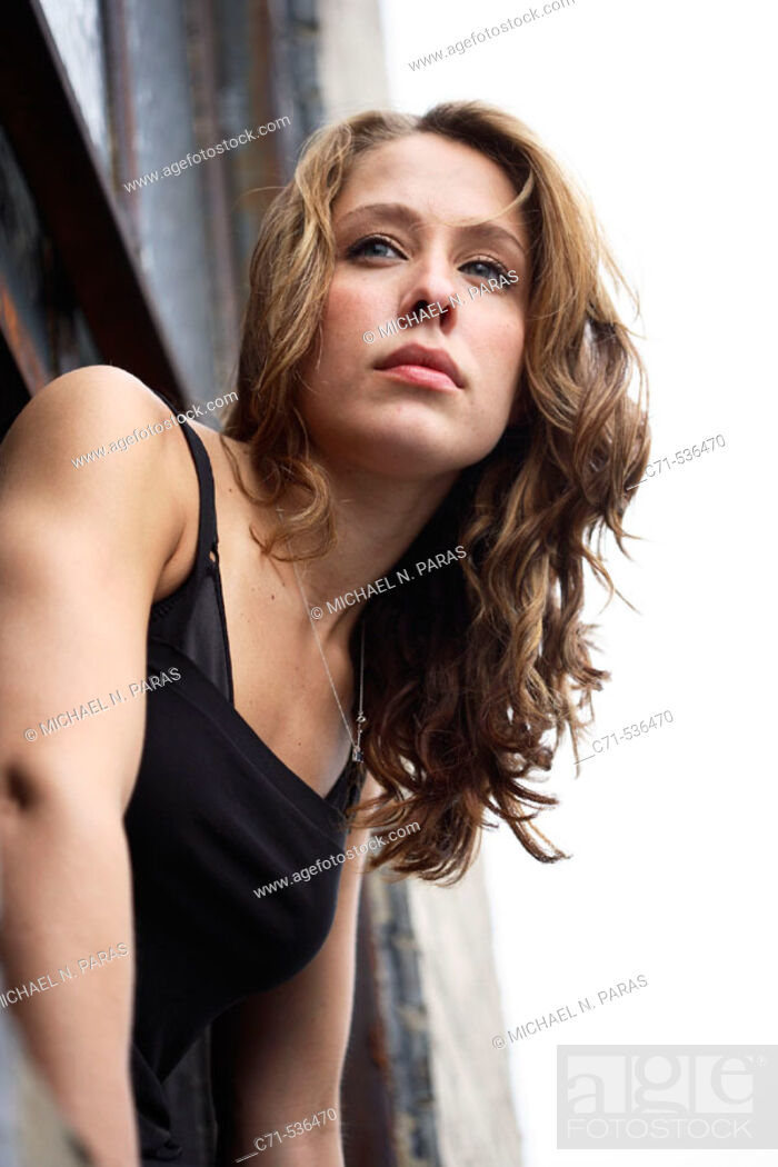 Stock Photo: Caucasian woman leaning out of the window.