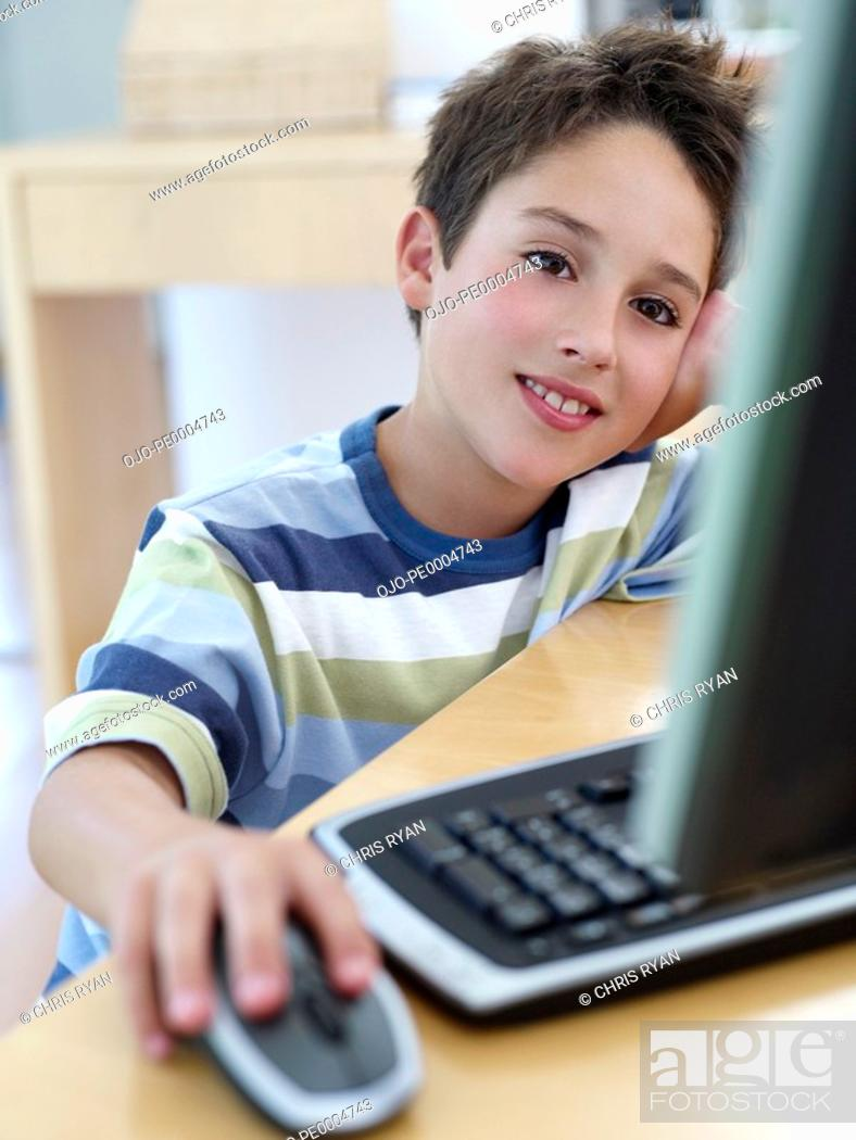 Stock Photo: Boy on computer.