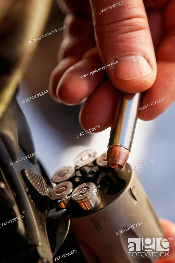 Imagen: Close Up Of Pistol Being Loaded With Bullets.