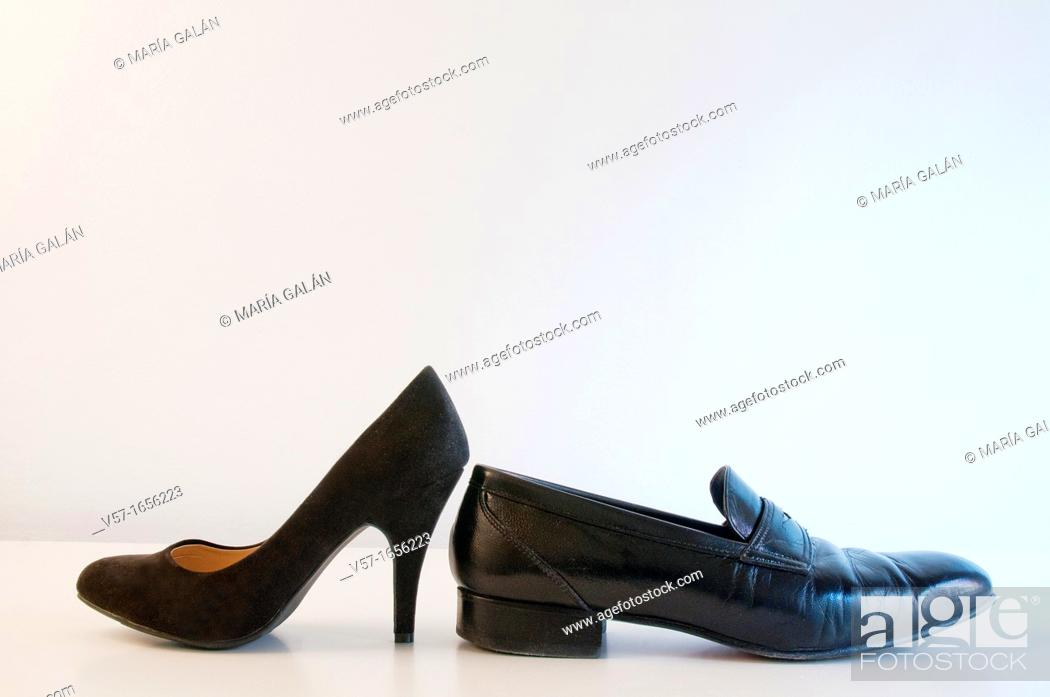 Stock Photo: Female shoe and male shoe.