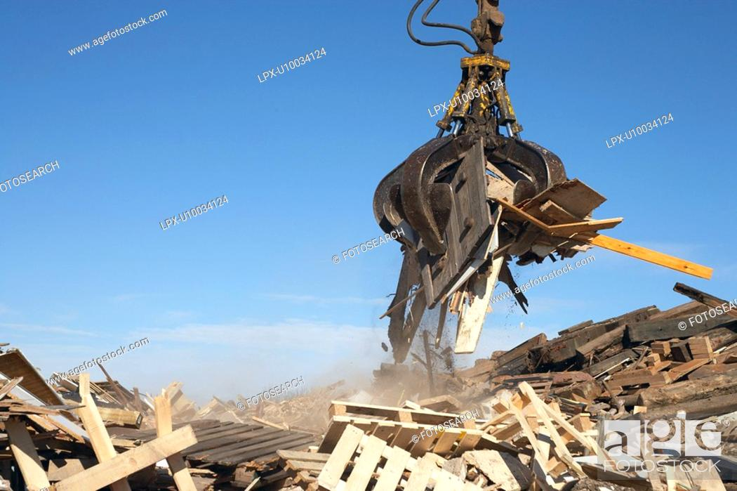 Stock Photo: Recycling plant. Construction waste being segregated for better recycling.