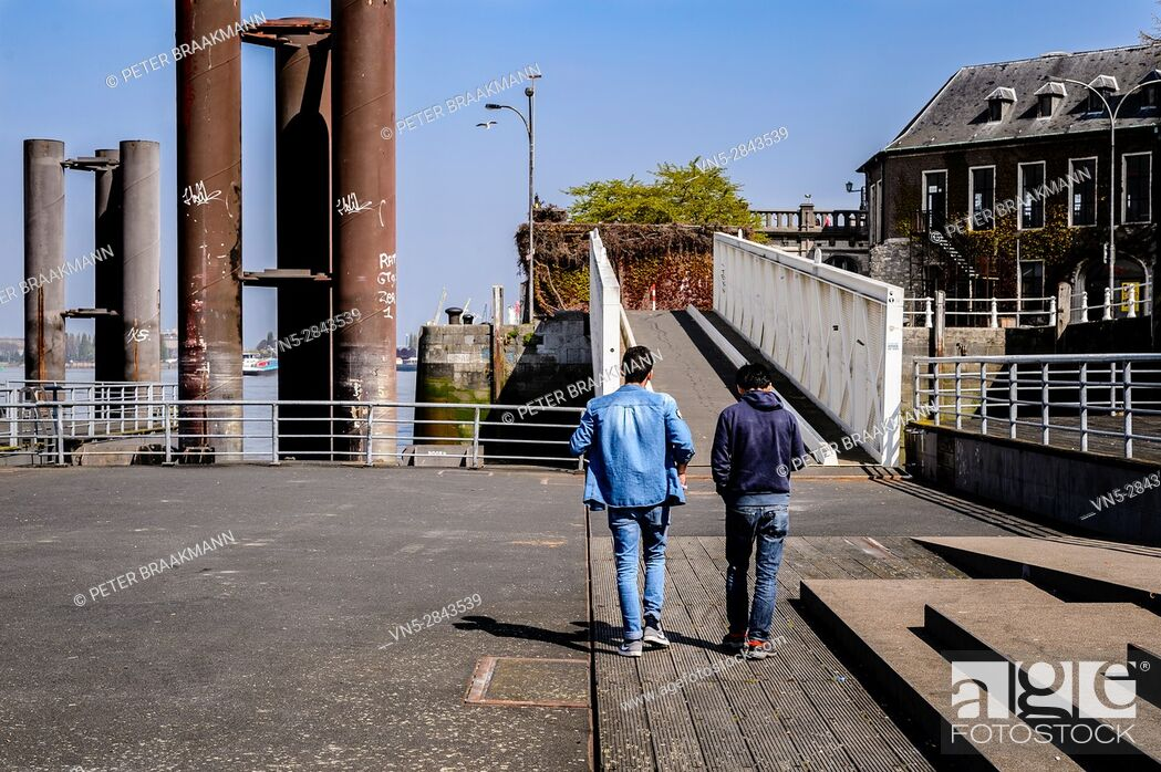 Stock Photo: Antwerpen, Belgium - Two young are walking outdoor in the city, talking and chatting - working, successful.
