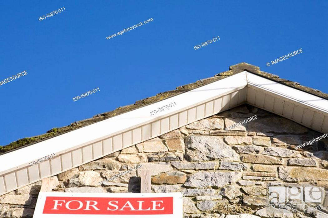 Stock Photo: For sale sign on house.