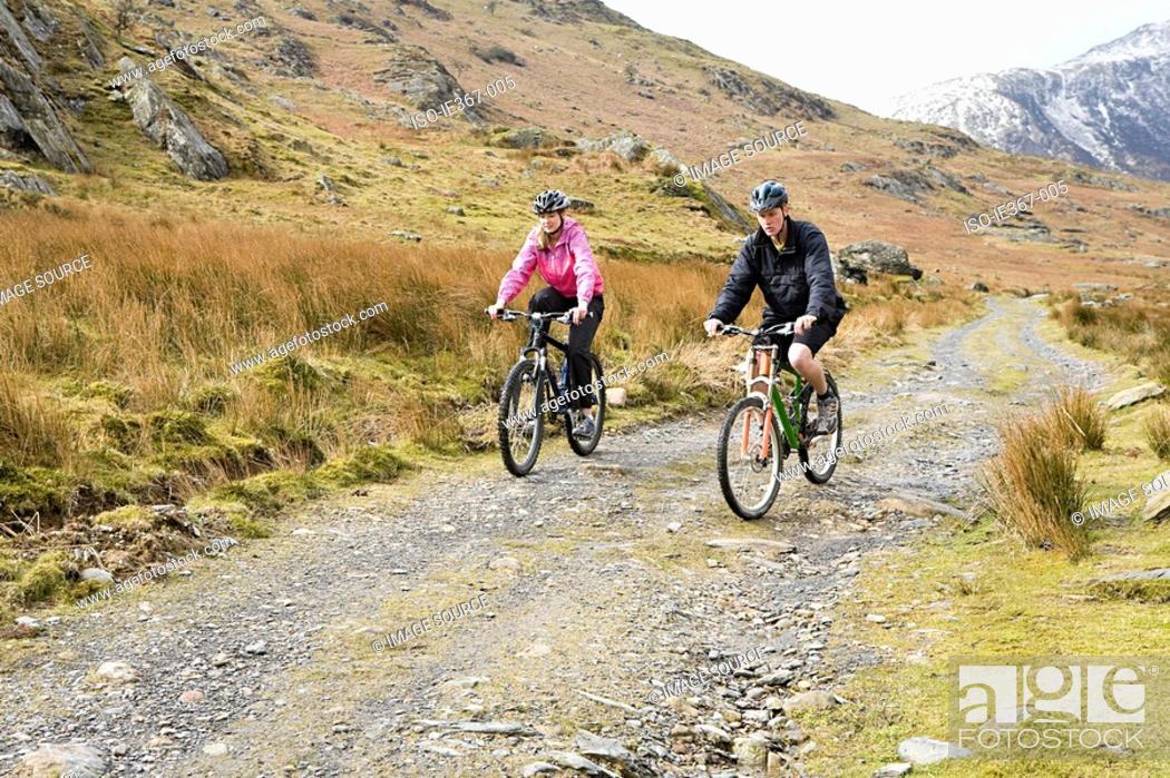 Stock Photo: A couple cycling.