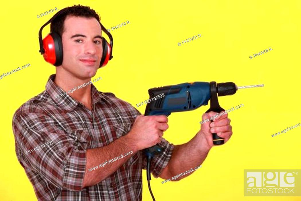 Stock Photo: Man holding an electric screwdriver.