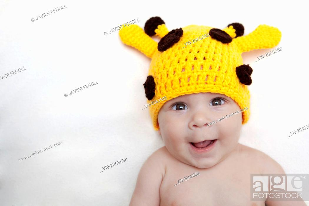 Stock Photo: Baby girl in giraffe hat.