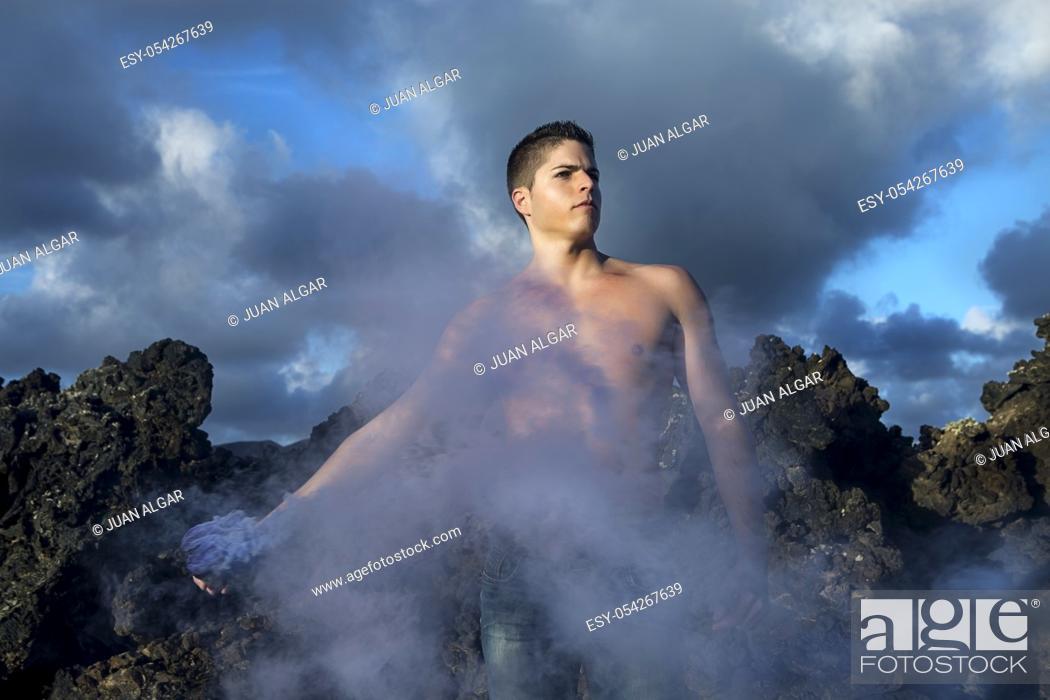 Stock Photo: Man holding a smoke box.