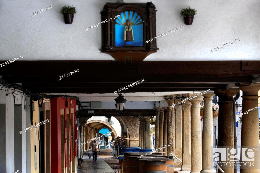 Stock Photo: Arcades and columns in Galiana street in the famous ancient city of Aviles, Asturias, Spain. One of the stops of the Transcantabrico Gran Lujo luxury train.