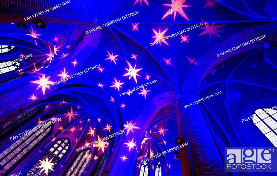 "Stock Photo: Picture of the festively illuminated Marktkirche in Hanover, Germany, 01 December 2017. The parish is holding a festive """"Advent Calendar""""."