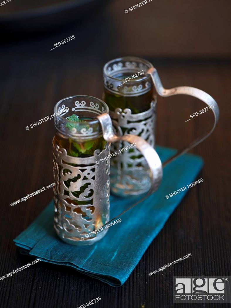 Stock Photo: Peppermint tea in Middle Eastern glasses.