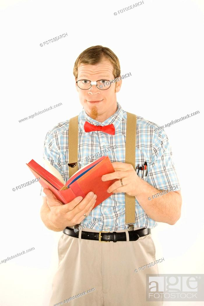 Stock Photo: Man dressed like nerd with book open.