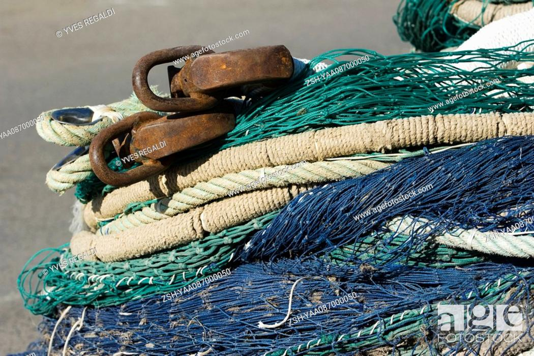 Stock Photo: Fishing nets and ropes in a heap, extreme close-up.