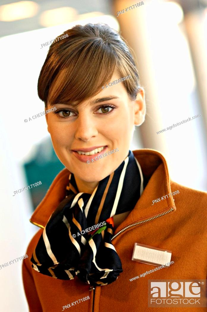 Stock Photo: Portrait of a female airline check-in attendant smiling.