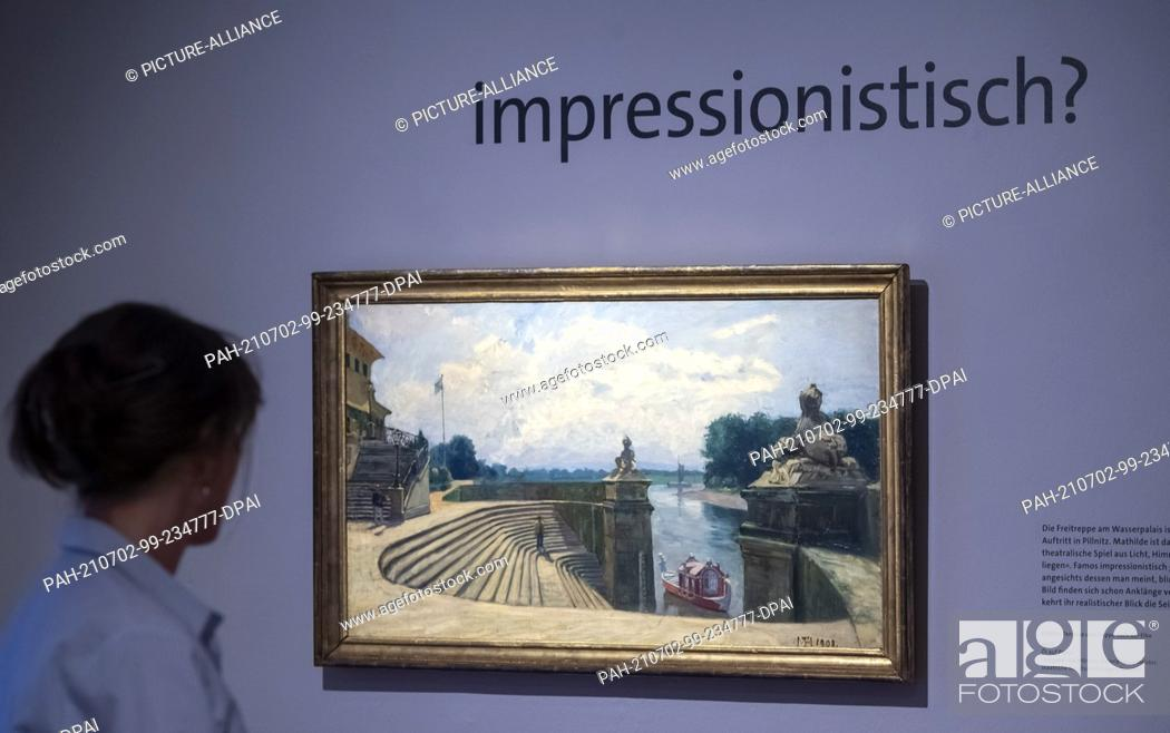 """Stock Photo: 02 July 2021, Saxony, Dresden: A visitor looks at the painting """"""""Pillnitz, Terrace and Stairs to the Elbe - 1908"""""""" by Princess Mathilde, Duchess of Saxony."""