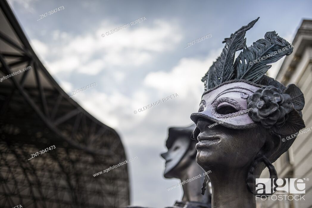 Stock Photo: Sculpture of people in carnival masks, Skopje, Macedonia.
