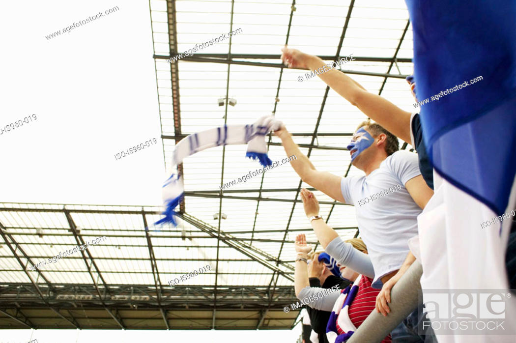 Stock Photo: Football crowd waving scarves.
