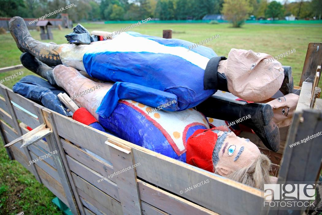 Stock Photo: Cardboard soldiers in a wagon on the day before the historic reenacting of the Battle of the Nations in a field in Markkleeberg, Germany, 17October 2014.