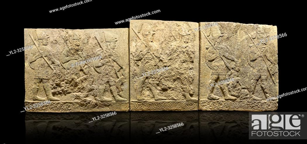 Stock Photo: Hittite sculpted orthostats panels of Long Wall Limestone, Karkamis, (Kargamis), Carchemish (Karkemish), 900-700 B.C. Soldiers.