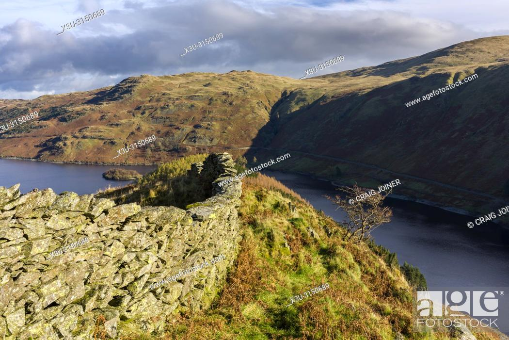 Stock Photo: Dry stone wall on Dudderwick overlooking Haweswater Reservoir and Mardale Common in the Lake District National Park, Cumbria, England.