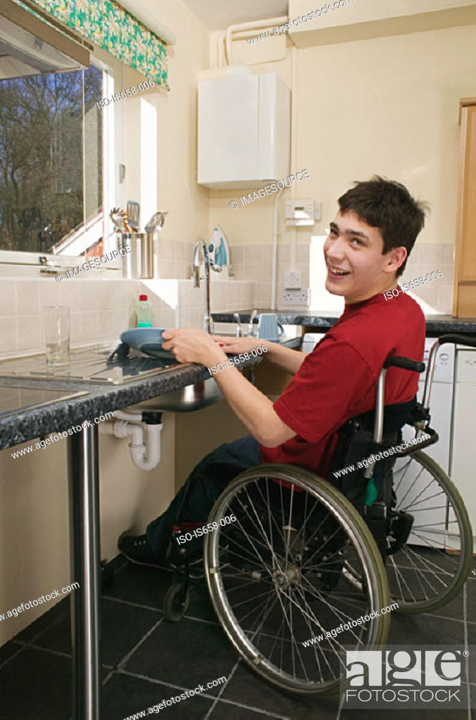 Stock Photo: Disabled man washing up.