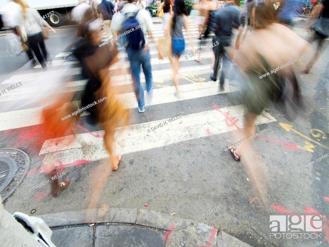 Stock Photo: Pedestrians in crosswalk in New York, New York, USA.